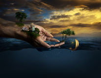 Hands holding life. In the open ocean Royalty Free Stock Photo