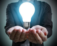 Hands of  holding light bulb Stock Images