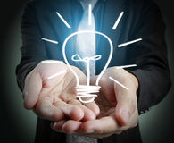 Hands of  holding light bulb Stock Image