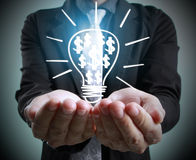 Hands of  holding light bulb Stock Photography