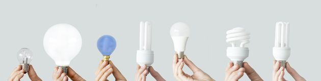 Hands holding the light bulbs stock images
