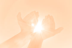Hands holding light Royalty Free Stock Photography