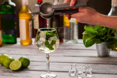 Hands holding lime squeezer. Royalty Free Stock Photography