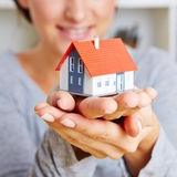 Hands holding a little house Stock Image