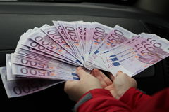 Hands holding a lot of money. Hands holding 20 thousand euros Stock Image