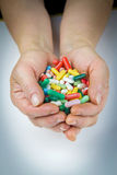 Hands holding a lot of pills Stock Photos