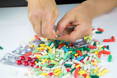Hands holding a lot of pills Royalty Free Stock Images