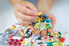 Hands holding a lot of pills Stock Photography
