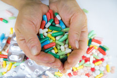 Hands holding a lot of pills Royalty Free Stock Image