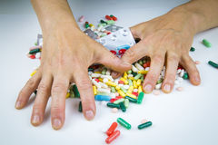 Hands holding a lot of pills Stock Photo