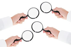 Hands Holding Magnifying Glass Royalty Free Stock Photo