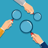 Hands holding a magnifying glass. Concept of searching, detecting and analyzing. vector illustration in flat design on blue background Royalty Free Stock Image