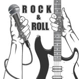 Hands holding a microphone and a guitar. Black and white vintage illustration. Hands holding a microphone and a guitar. Black and white vintage illustration Stock Photo