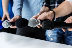 Hands holding microphone for an interview Stock Images