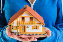 Hands holding miniature house model Royalty Free Stock Photos