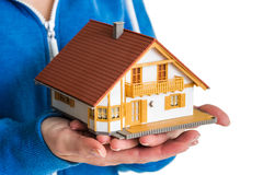 Hands holding miniature house model Stock Photography