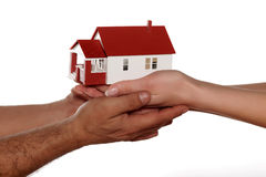Hands holding miniature house. Miniature model house in human hands Stock Photos