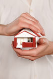 Hands holding miniature house. Miniature model house in human hands Stock Images