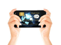 Hands holding mobile phone with credit card screen Royalty Free Stock Photos