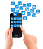 Hands holding mobile phone with icons. Stock Image