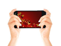 Hands holding mobile phone with valentine screen Stock Photos