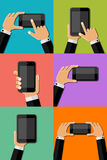 Hands holding mobile phones. Vector illustration Stock Photos