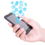 Hands holding mobile smart phone with different applications and Stock Images