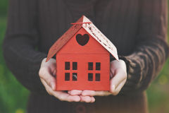 Hands holding model of house Stock Photography