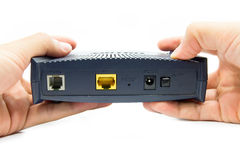 Hands holding a modem. Stock Photo