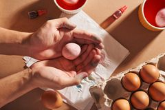 Hands holding modern painted easter eggs. Selective focus.  royalty free stock photography