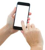 Hands holding a modern smartphone. Someones hands holding and touching  modern black smartphone isolated on white background with copy space Royalty Free Stock Photography