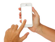 Hands holding a modern smartphone. Someones hands holding and touching  modern smartphone isolated on white background with copy space Stock Images