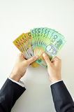 Hands holding money - Australian dollars Royalty Free Stock Photos