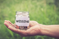 Hands holding money in the jar Royalty Free Stock Photography