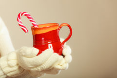 Hands holding mug and cane. Stock Photography