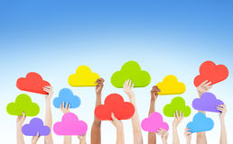 Hands Holding Multi Coloured Cloud Shaped Stock Photos