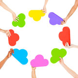 Hands Holding Multicoloured Cloud Shaped Royalty Free Stock Photo
