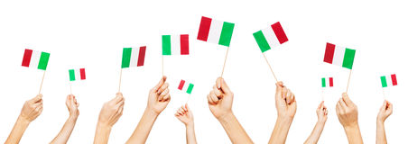 Hands holding the national flags of Italy Royalty Free Stock Images