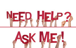 Hands Holding Need Help, Ask Me. Many Hands Holding the Words Need Help, Ask Me, Isolated Royalty Free Stock Photos