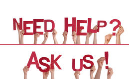 Hands Holding Need Help, Ask Us. Many Hands Holding the Red Words Need Help, Ask Us, Isolated Royalty Free Stock Photos