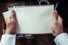 Hands holding notebook stock image