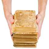 Hands holding old books Royalty Free Stock Photography