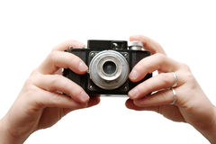 Hands holding an old camera. Isolated Stock Photography