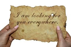 Hands holding old parchment with the words `I am looking for you everywhere` stock images