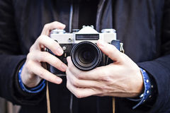 Hands holding an old photo camera Royalty Free Stock Image