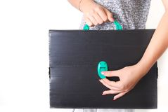 Hands Holding an old and ruined Technical Black Briefcase Royalty Free Stock Image