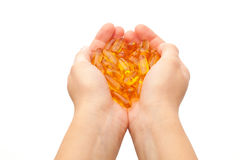 Hands holding omega-3 fish fat oil Royalty Free Stock Photo