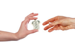 Hands holding a one dollar Royalty Free Stock Image