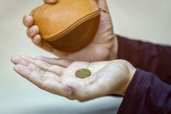 Hands holding one dollar coin royalty free stock image