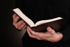 Hands holding open   bible Royalty Free Stock Image